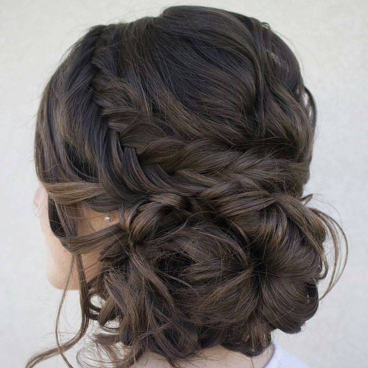 braided and curled low updo
