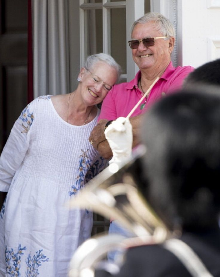 Queen Margrethe II of Denmark and Prince Henrik of Denmark watch the changing of the guard at Grasten Castle, 25.07.2014 in Grasten, Denmark.