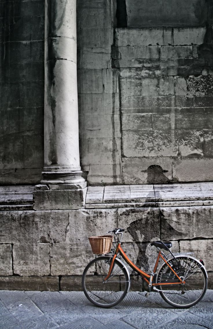 Perfectly parked bike. Lucca, Italy.