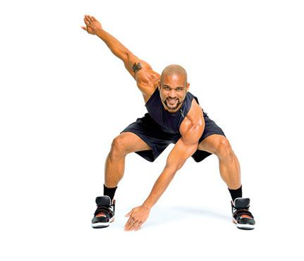 Stance Jacks: Stand with feet together, arms raised to chest level, elbows out, fingertips touching. Jump into a wide squat, pushing hips back as you reach left hand toward right foot, right arm extended behind you (as shown). Jump back to start. Repeat quickly on opposite side. Continue alternating for 1 minute.