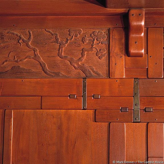The Gamble House   Detail of carved living-room frieze with adjacent boards, blocks, and iron straps — decorative elements that mimic functional features in other areas of the house.