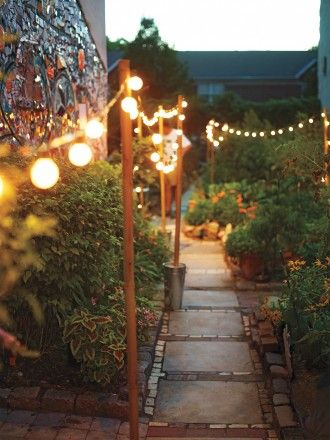 Cafe Lights On Wooden Poles   Lighted Pathways
