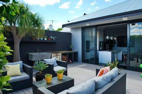 A beautiful reno in Mt Lawley and saying 'no to a red feature wall' | the traveller's return exterior shot looking into the kitchen featuring a metters stove landscape garden and beautiful colours