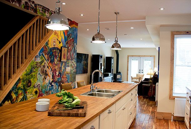 """Brock Street Renovation - The home owners invited their artist friends to """"graffiti"""" the wall under the stairs creating a personalized mural and a great splash of colour."""