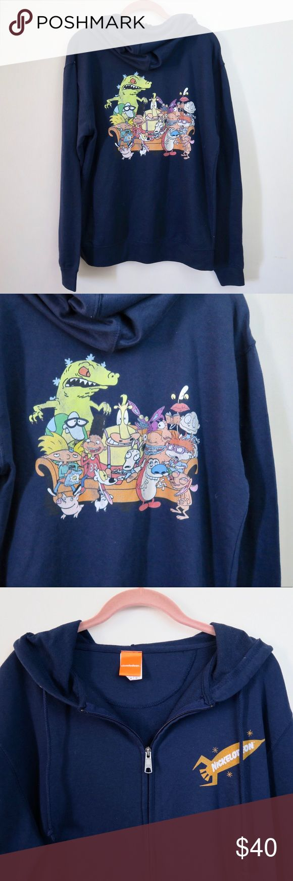 "Nickelodeon 90s Kids Group Hoodie Calling all you 90s kids! Whether your favorite was Rugrats, Aahh!! Real Monsters, Hey Arnold!, or Ren & Stimpy, this is the hoodie for you. This navy zip up hoodie has a vintage screen featuring all of your favorite Nickelodeon characters, and will make you feel just as warm as the rush of nostalgia does.       55% cotton; 45% polyester     +Length: 27"", chest: 22"" across      No flaws. Worn 2x, hung dried not dried in dryer.     Listed in men's sizes…"
