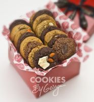 Medium George Box — 24 gourmet cookies gift wrapped in a shiny red box with ribbon and a gift tag.