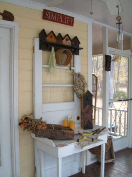 screened  porch.. cute idea for old door