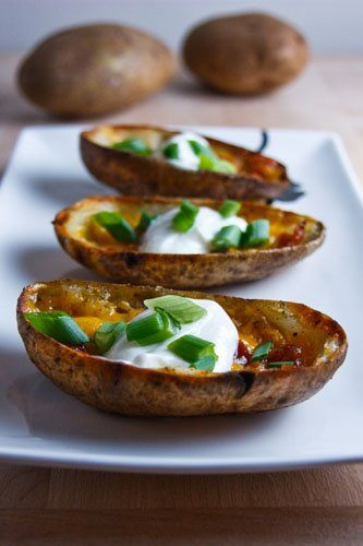 Potato Skins -- potatoes (such as russet, scrubbed clean), canola oil, crumbled bacon, grated cheese, sour cream, green onions, salt and pepper to taste