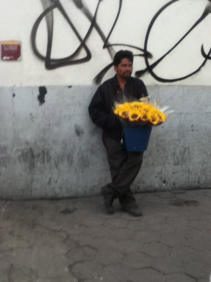 I decided to take this picture in Oaxaca, Mexico. This stood out to me because  the ravishing and decorative flowers that the poor man is selling contrasts his surroundings, of dirty and abandoned streets.