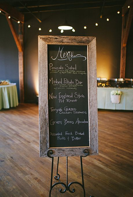 Brides.com: A Casual Nashville Wedding with a Rustic Theme. A framed chalkboard announced guests' dinner options, which included panizala salad, pot roast, teriyaki-glazed chicken skewers, green beans almondine and a mashed potato bar.