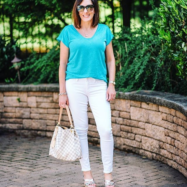 Taking a break from packing for vacation to share today's look for church and lunch after. 😎 . White jeans + elevated tee + wedge sandals is one of my favorite summer outfit formulas. All details linked in bio. .