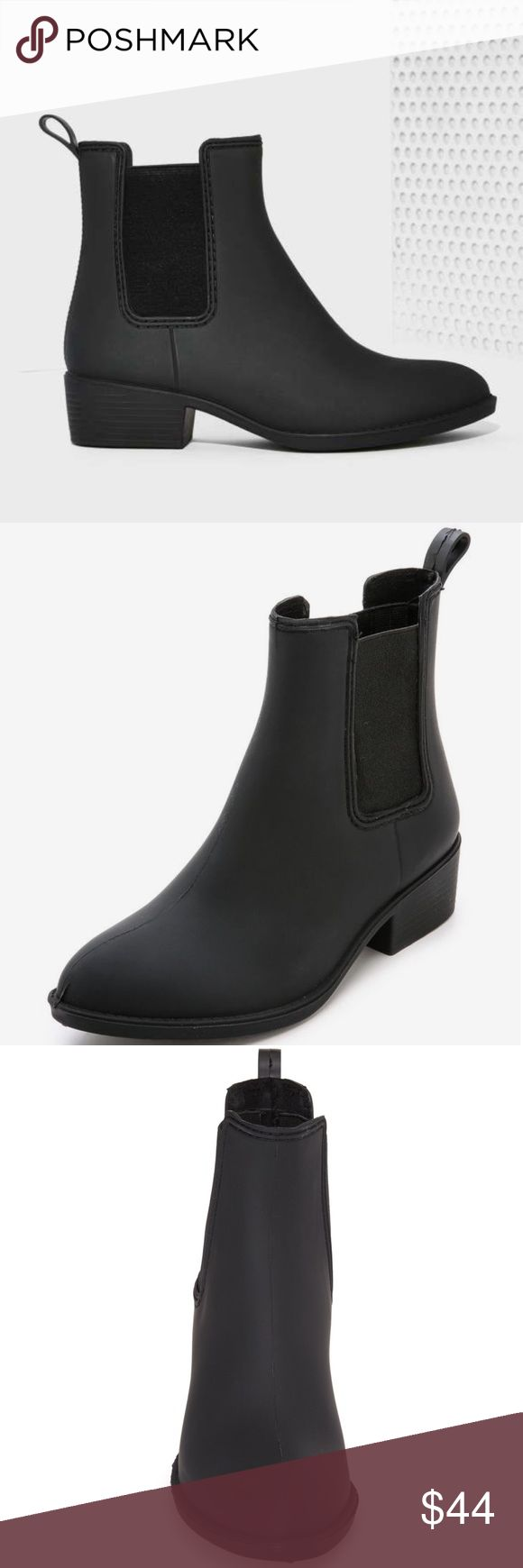 NEW Black Sleek Chelsea Rain Boot Ankle Boots •Brand New in Box • Black Chelsea Rain Boots • All materials are vegan • Rubber • Stretchy Elastic to make Boot easy to put on and take off • True to size• Feel free to ask questions!• 🌸 www.thefairyden.com 🌸 Shoes Winter & Rain Boots