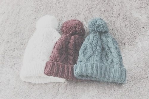 Cosy bobble hats in muted / milky shades.