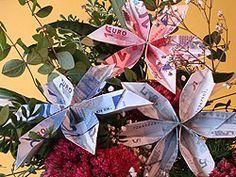 Eine Geld-Blume falten - deutsche Bildanleitung