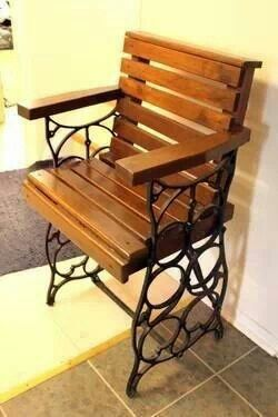 Old sewing machine stand turned upside down & converted into a chair.