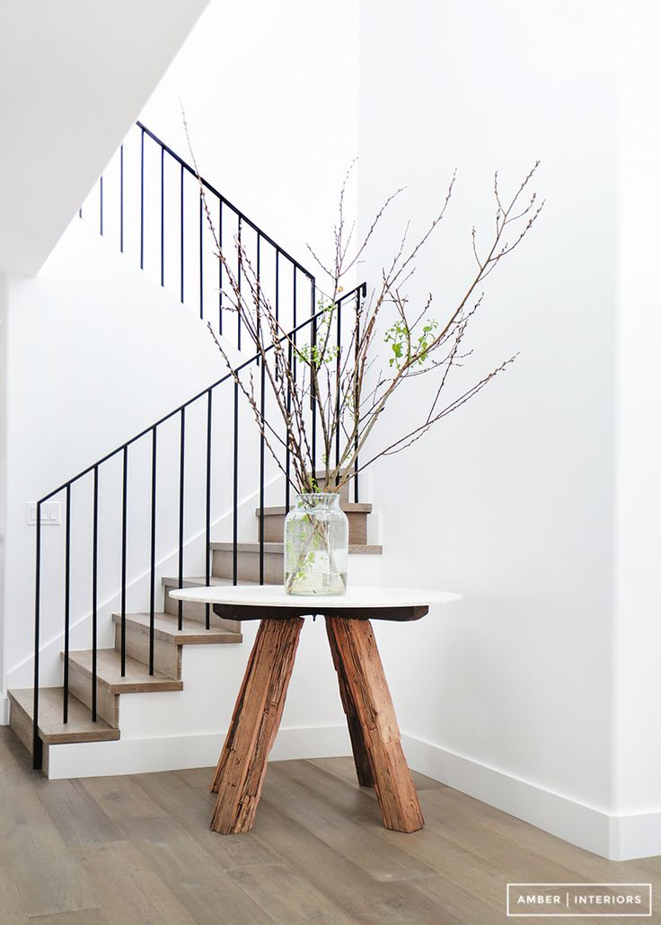 Entryway table and vase with branches