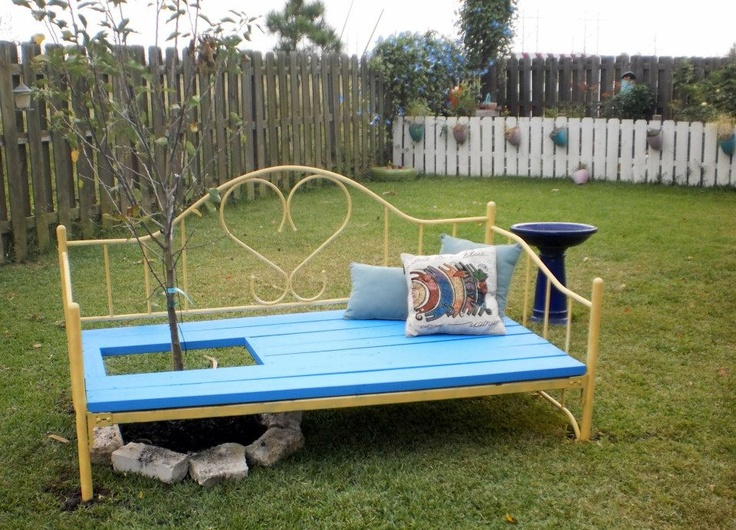 Discarded day bed frame...re-purposed into an outdoor bench...we planted an Anna Apple tree inside it & morning glory seeds to vine. Can't wait until things start growing! Still gonna make some outdoor cushions to lounge on