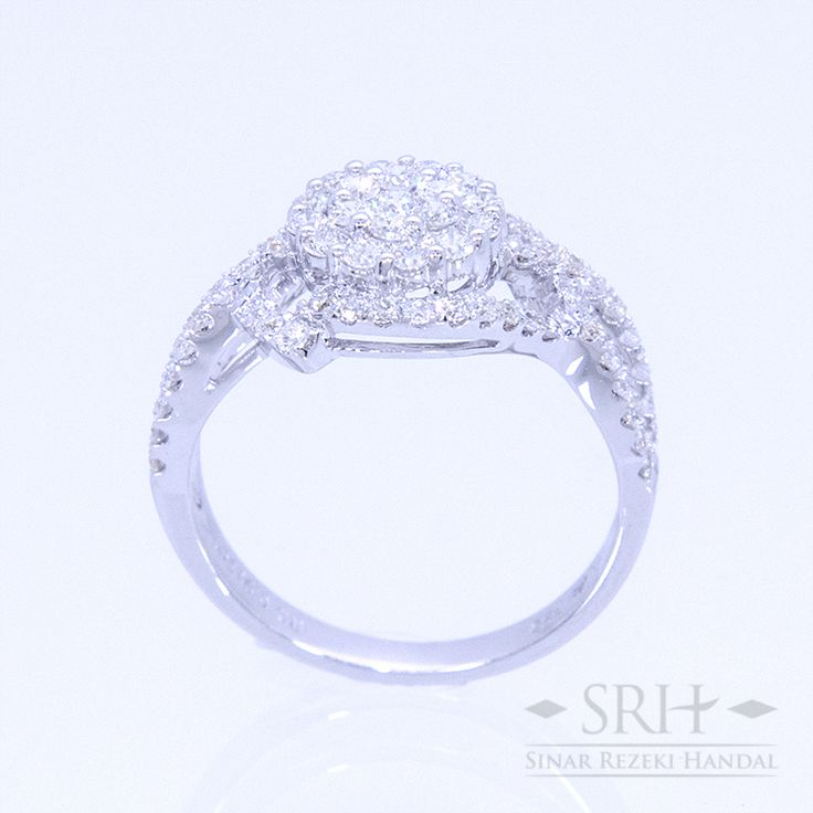 27731 18Karat White Gold Weight 3.72 gr Ring Size 13 0.864 Total Carat = 74 Rounds Diamond 0.049 Total Carat = 1 Rounds Diamond