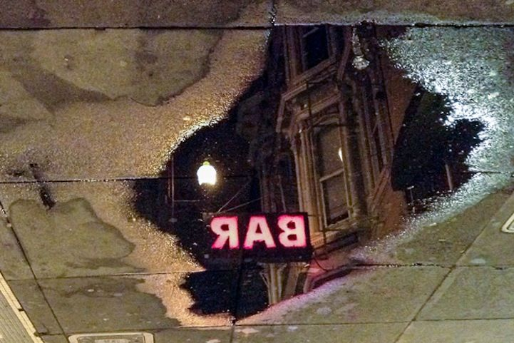 San Francisco Cityscapes Reflected in Fragmented Puddles