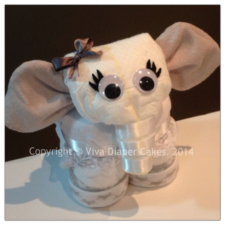 Grey elephant diaper cake animal. Unlike some diaper animals, all diapers, washcloths and socks are 100% useable upon disassembly! Tutorials coming soon. Follow this board for updates. Like my page on Facebook if you like my diaper animal designs. www.facebook.com/vivadiapercakes