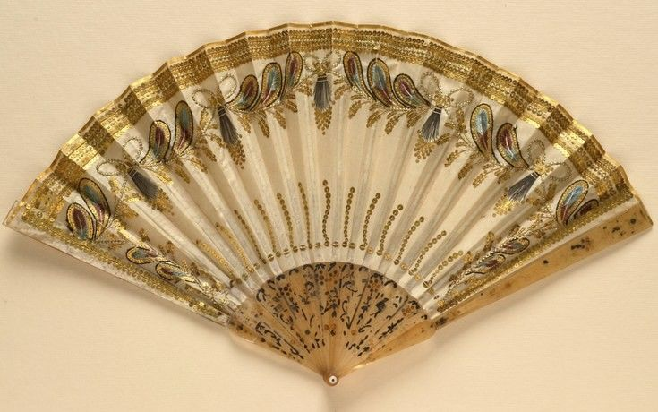 Folding fan of horn sticks with a silk leaf embroidered with feather motifs and decorated with sequins. English c1800. Fan Museum, Greenwich