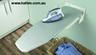 Ironfix Ironing Board: Wall mounted for kitchens or laundries.