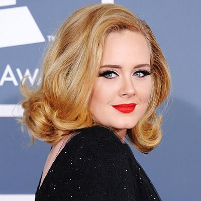 """Adele, 2012 Grammys  """"She lightened up for the Grammys, courtesy of colorist Lucy Holbrook at London's Daniel Galvin salon. """"We decided to color Adele's hair a honey-colored blond as it suited her complexion and really brought out the color of her eyes,"""" Holbrook told People.com. """"It was important to elect a color with plenty of depth to complement the bouncy voluminous styles that she favors."""" """""""