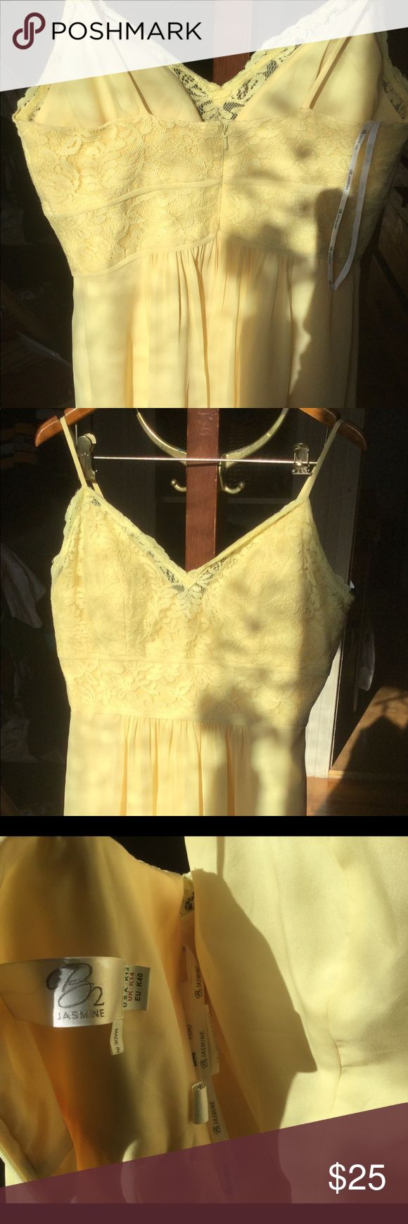 Stunning pale yellow dress size 12 nwot Never worn, this beautiful dress is perfect for most any occasion that requires a bit of feeling sensual and elegant. Soft and pretty, light yellow color is gorgeous Jasmine Dresses