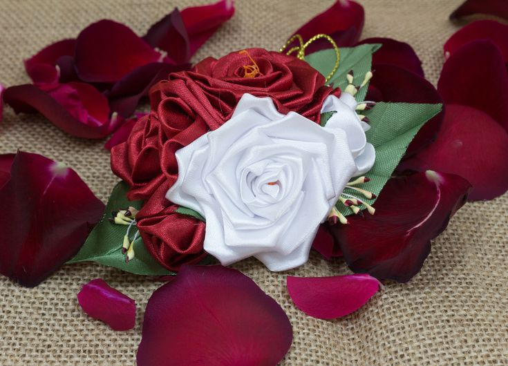 A personal favourite from my Etsy shop https://www.etsy.com/ie/listing/586530951/lovely-red-roses-brooch-kanzashi-silk