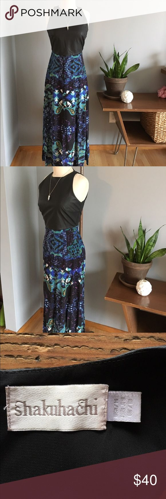 Shakuhachi Watercolor Maxi Dress Shakuhachi Maxi Dress size U.K. 10 / US M. Vegan leather bodice with sleek high neck, sleeveless and darted at bust. Watercolor patterned Maxi skirt, opens in multiple slits from thigh down for super breezy boho feel. Equally beautiful styled with a stacked heel or casual with a gladiator sandal. Shakuhachi Dresses Maxi