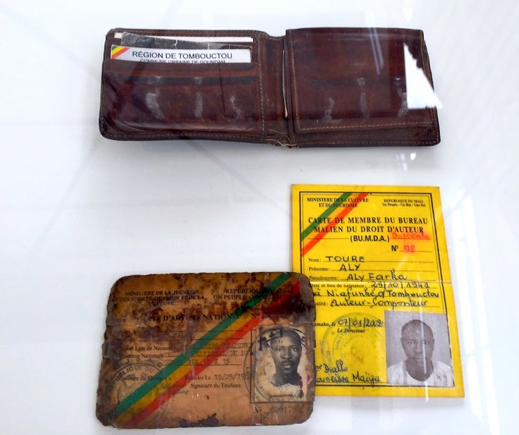 "ID cards of Ali Ibrahim ""Ali Farka"" Touré, as displayed in documenta 14. Image: Ben Davis."