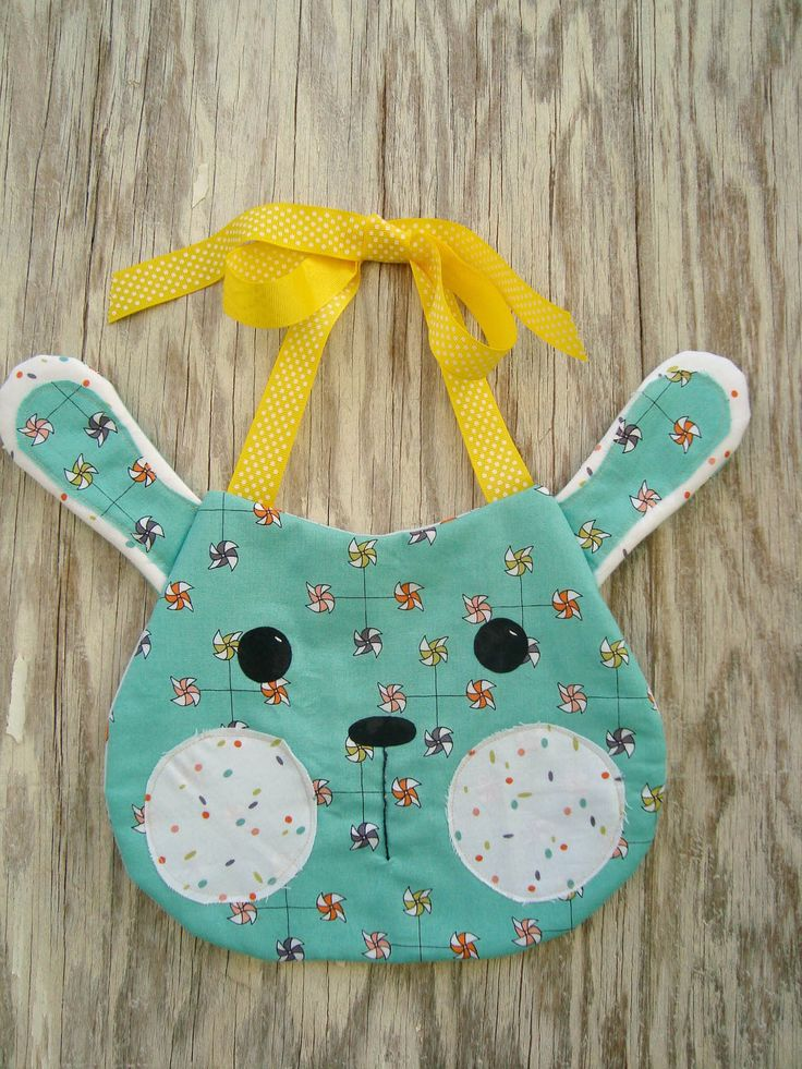 "Bunny Bib By Jorgensen, Becky  - 8-3/4in x 7in (Excluding Ears) Project Time: -2 Hour Fabric Type: Fat Quarter Friendly Project Type: Craft  CLP patterns are printed on 8-1/2"" x 11"", anti-copy card stock. Because they are customized with your shop's Bill-to account name, phone number and web site, they are not returnable."