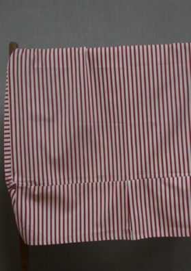 Red & ecru cotton ticking single bed box pleated valance. This is slightly longer than a standard single at 105 x 194cm, but a little shrinkage will occur in the first wash. The drop is 26cm.
