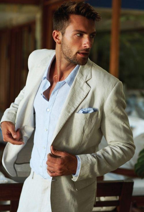 Comprar ropa de este look: https://lookastic.es/moda-hombre/looks/blazer-beige-camisa-de-vestir-celeste-pantalon-de-vestir-beige-panuelo-de-bolsillo-celeste/838 — Camisa de Vestir Celeste — Pañuelo de Bolsillo de Seda Celeste — Blazer Beige — Pantalón de Vestir Beige