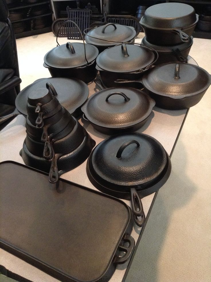 Lodge hammered set.  Shown here are skillets nos 10 w/lid, 9, 8 w/lid, 7, 5, 3, 2, 1s, 1, 0, 00.  Three different variations of 8 dutch oven and a 9 DO.  A 8 long griddle, 7, 8 and 9 hand griddle, 4N1 double skillet, A early 8 double skillet set, and a  7 DO cover. Also a 8 chicken fryer w/lid.   Known but not shown a pot to a 7 DO ,a sauce pan and a 8 DO with a thermometer in the lid and a 9 & 10  long griddle.