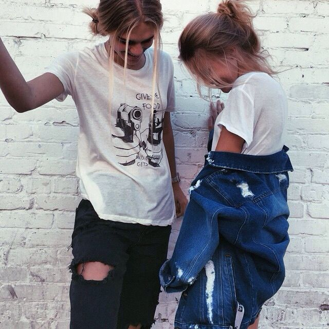 Distressed black pants and oversized white shirt