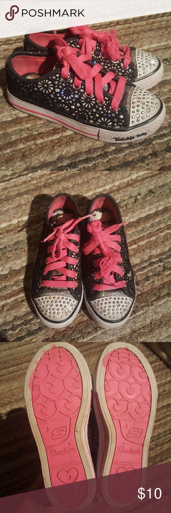 Girls sneakers Sketchers brand, Twinkle toes and the lights still work, black lacey overlay with silver sparkle underneath, pink laces, which need replacing. Used condition but still in good condition. See photos for laces Skechers Shoes