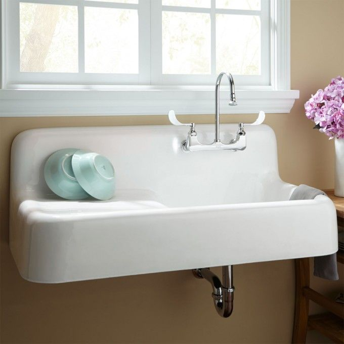"(Basement) 42"" Cast Iron Wall Hung Kitchen Sink @ $995, the list price is $1,344.95   signaturehardware.com"