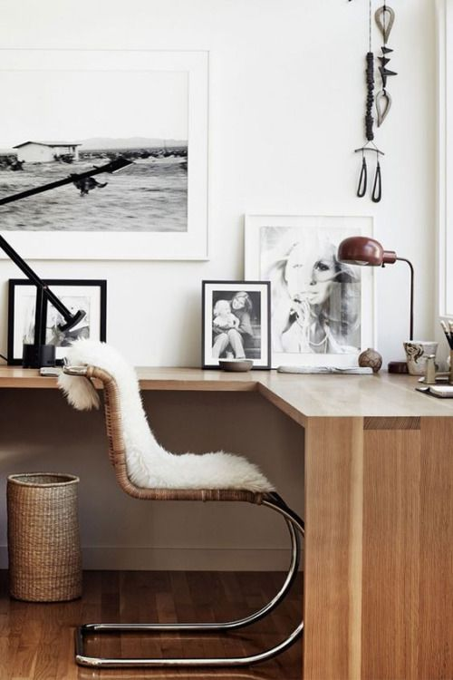 Gorgeous workspace - warm wood tones and airy whites, Black and white photograph and fur covered chair