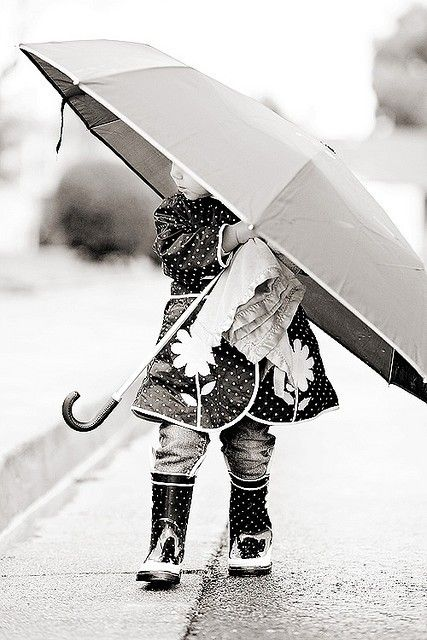 Black and white photo.....big umbrella and little girl...