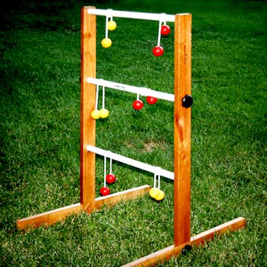Also called Flingy Pongy, Ladder Golf is a tethered ball toss where players try to get their roped balls around the rungs of a three-tiered ladder. The DIY version of the ladder can be constructed of PVC pipes; make the bolas—tethered balls—by drilling through golf balls, stringing them with nylon cord, and knotting.