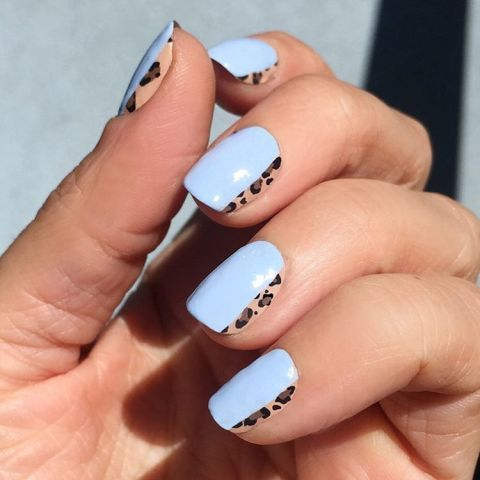 Leopard is a classic fall pattern, but we're not completely over summer pastels.  Paint one edge with a leopard design and let dry.  Add a cotton candy blue lacquer over two-thirds of your nail, so the animal print breaks through.  Set with a clear topcoat.   Design by @aliciatnails