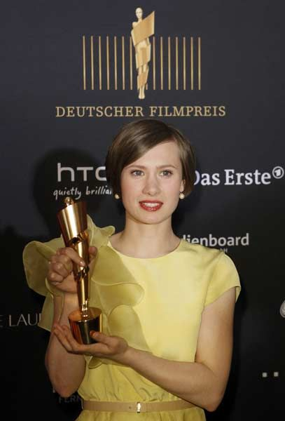 "Actress Alina Levshin poses with the award for the best female role in the film ""Die Kriegerin"" (Warrior) during the German Film Prize (Lola) ceremony in Berlin April 27, 2012."