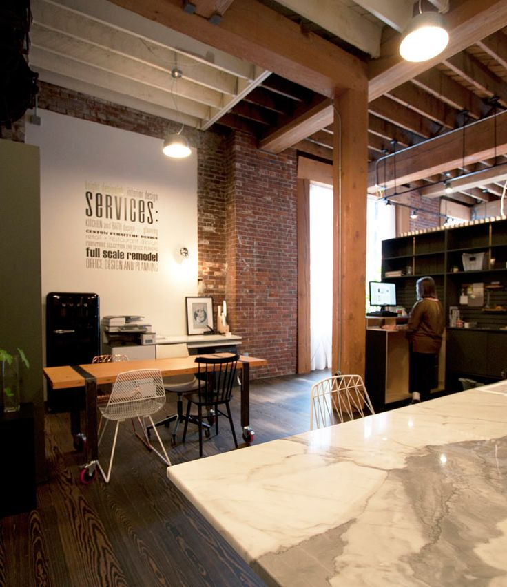 Loft design studio with high ceilings and marble table