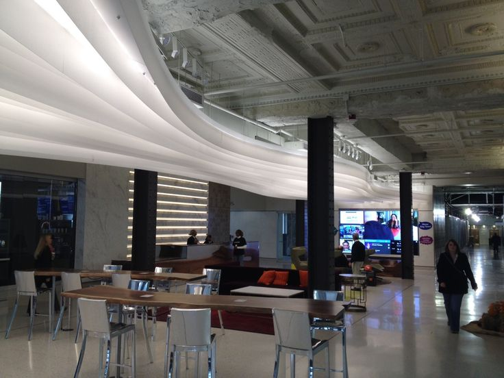 Lumicor Glacier Ribbon Ceiling Feature Emeco Hand Polished Stools at First  National Bank