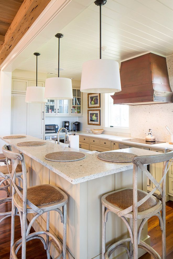 kitchen island with seating for 4 recessed panel cabinets white countertops chairs hardwood floors pendants sink subway tile backsplash decorations farmhouse design of Fabulous Islands to See If You Want a Kitchen Island with Seating for 4