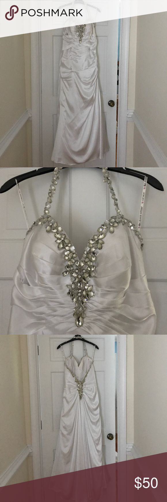 "White and Rhinestone Trim Prom Dress This simple and gorgeous dress reminds me of vintage Hollywood! It hugs all the right places and flows nicely! The over the neck strap is dripping with bling as is the front and back top parts of the dress. It is a size 14 and was worn by a girl who is 5'0"" with 3 inch heels. It was only worn once and then hung up. It was purchased at a bridal boutique. Dresses Prom"