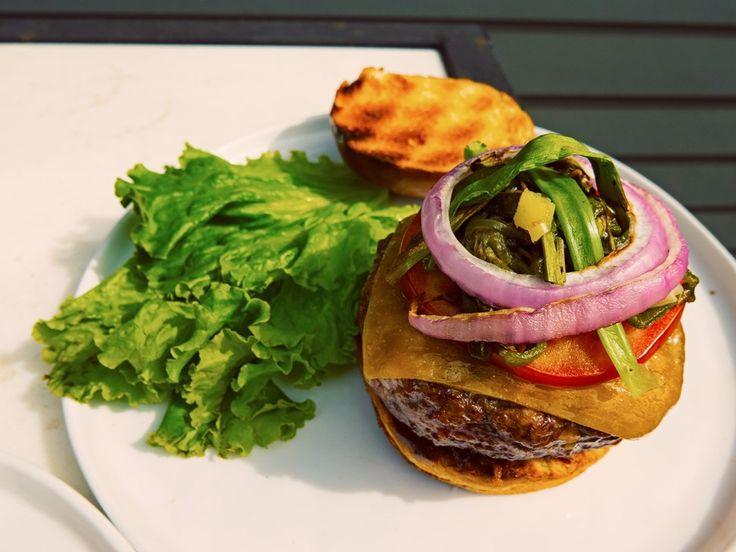 Juicy lucy (stuffed burger) with a bite - http://3000acrekitchen.com/juicylucy-burger