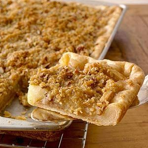 Crumb topped Apple Slab Pie - What's better than apple pie? More apple pie! With juicy apples underneath a buttery oat topping, this terrific potluck recipe makes a whopping 25 servings./