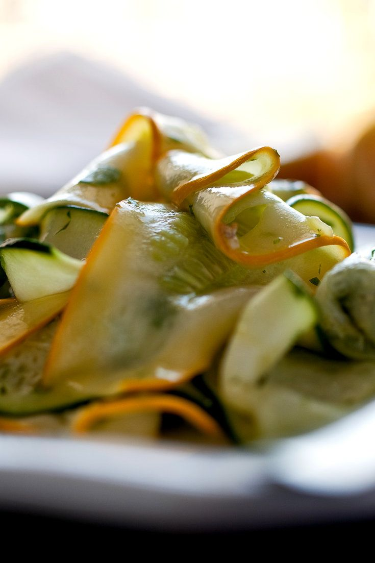 Raw zucchini can be a dull ingredient, but when it's very thinly sliced it marinates beautifully, especially in lemon juice. I like to use a mixture of green and yellow squash here. (Photo: Andrew Scrivani for The New York Times)